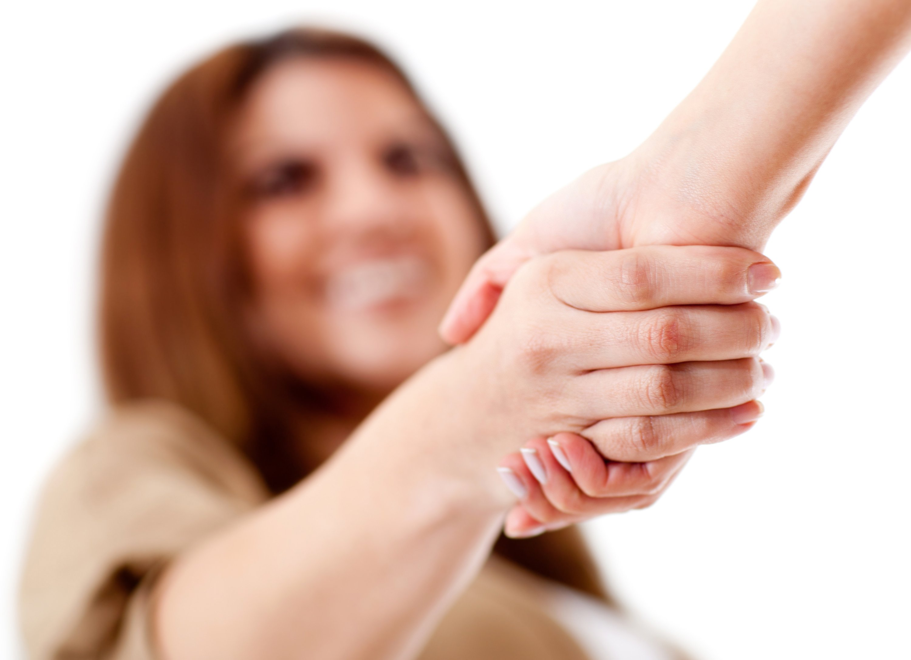 Friendly handshake - isolated over a white background